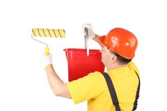 Worker with roll and bucket. Royalty Free Stock Photo