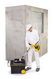 Worker with roller and primer Royalty Free Stock Images