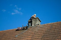 Worker on the roof Stock Image