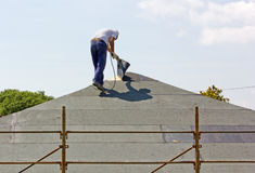Worker on a Roof Stock Images