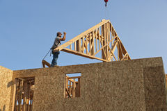 Worker with roof truss frame Stock Photos