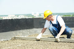 Worker roofer with float lute Stock Image