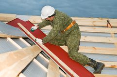 Worker at roofing works royalty free stock photography