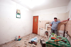 Worker in room renovation Stock Image