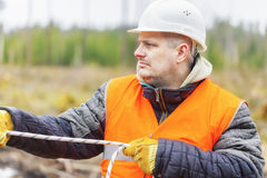 Worker with rope at outdoors Stock Images