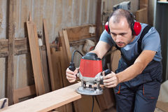 Worker with a router, horizontal Stock Photos