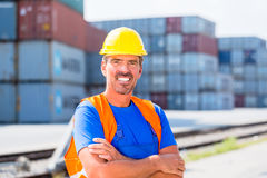 Worker and row of containers on port Royalty Free Stock Images