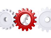 Worker running inside of a cogwheel Royalty Free Stock Images