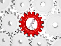 Worker running inside of one cogwheel out of many. 3d worker with tie is running inside of one cogwheel out of many Stock Photos