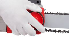 Chain tension on the electric saw Royalty Free Stock Images