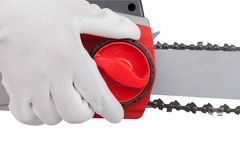 Chain tension on the electric saw Stock Photo