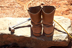 Worker's Boots and Hammer Royalty Free Stock Images