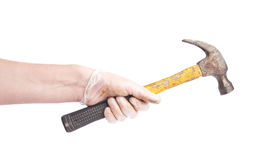 Worker's caucasian male hand holding tool. Worker's caucasian male hand in a dirty rubber glove holding a hammer tool, composition isolated over the white Stock Photography