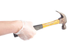 Worker's caucasian male hand holding tool. Worker's caucasian male hand in a dirty rubber glove holding a hammer tool, composition isolated over the white Royalty Free Stock Images