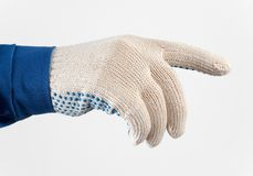 Worker's hand in gloves holding something. Worker's hand in protective gloves holding something  isolated over white Royalty Free Stock Image