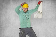 Worker`s madness, empty construction plans. Protective helmet on the head Royalty Free Stock Image