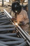 Worker with safety equipment and protective mask welding steel. Stock Photo