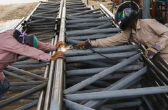 Worker without safety protective welding steel structure in cons Stock Images