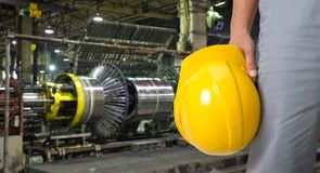 Worker with safety helmet. At industrial factory Stock Photography