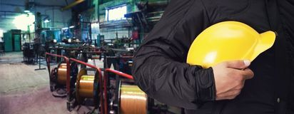 Worker with safety helmet. At industrial factory Stock Photo