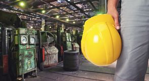 Worker with safety helmet. At industrial factory Royalty Free Stock Image