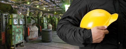 Worker with safety helmet. At industrial factory Stock Photos