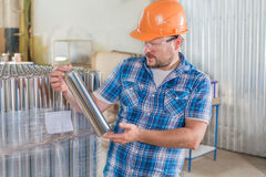 Worker in safety helmet at the storage Royalty Free Stock Photography