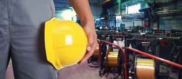 Worker with safety helmet. At industrial factory Royalty Free Stock Photo