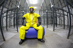 Worker in safety - protective uniform,sitting on b Stock Photography