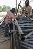 Worker without safety protective welding steel structure. Stock Image