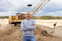 Worker  at sand pit. Portrait of worker  at sand pit Stock Image