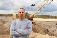 Worker at sand pit. Portrait of worker at sand pit Royalty Free Stock Photography