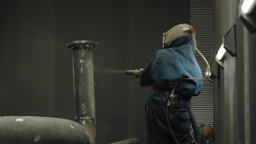 Worker Sandblasting Gas Pipe stock video