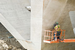 Worker Sanding Cement Seams Stock Image