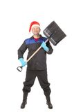 Worker in santa hat with shovel. Royalty Free Stock Image