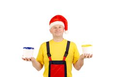 Worker in santa hat with two buckets Stock Images