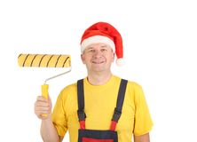 Worker in santa's hat with roll. Royalty Free Stock Photos