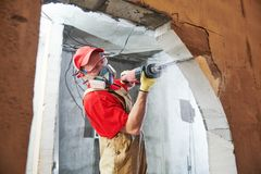 Free Worker Sawing Doorway With Sabre Saw. Home Renovation Royalty Free Stock Images - 119749559