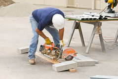 Worker Sawing Metal Studs Royalty Free Stock Photos