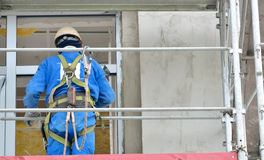 Worker on a scaffold Royalty Free Stock Image