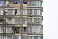Worker scaffolding on the side of the building stock photography