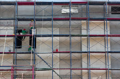 Worker with scaffolding in site construction Stock Photo