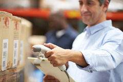Worker Scanning Package In Warehouse Stock Images