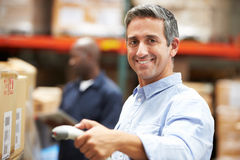 Worker Scanning Package In Warehouse Royalty Free Stock Photo