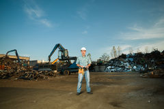 Worker in scrap metal recycling center Royalty Free Stock Photos