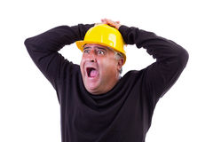 Worker screaming with hands on his  head. On white Stock Photography