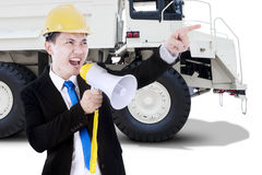 Worker screaming with megaphone and truck Royalty Free Stock Image