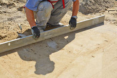 Worker screeding sand bed Stock Photography
