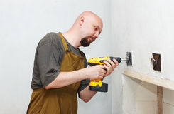 Worker with screwdriver Stock Photos