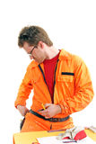 Worker searching tools on a belt Stock Photos